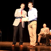 First Flight High School senior Ian Kenny was presented the prestigious, four-year renewable Milton A. Jewell Academic Scholarship for a total of $24,000 by Scott Brown, a member of the Board of Directors of the Outer Banks Community Foundation. (Photo by Helen Woolard, Visuals by Helen)